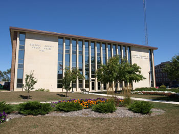 South side of the courthouse, with flowered landscape in the foreground