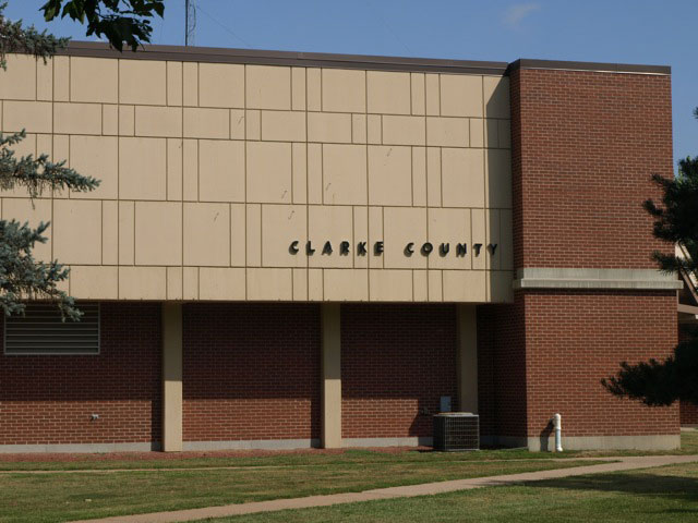 "southwest corner, origingal building, with raised text ""Clarke County"""