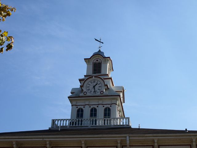 White-faced Clock in a white tower atop the Clayton County Courthouse.