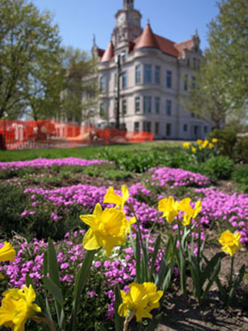 Flower garden on the southeast corner of the courthouse lawn. The courthouse is in the background