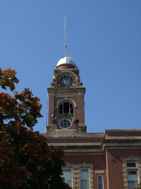 Close view of the clocktower. There is scaffolding along one side.