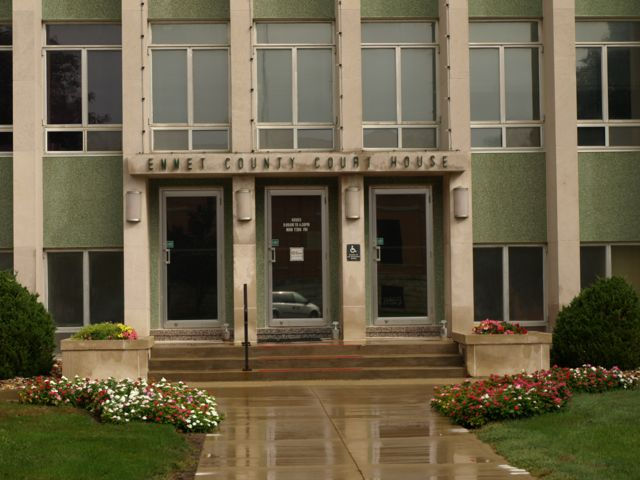 Closer view of the entrance. Emmet County Court House is in raised black text over the doors