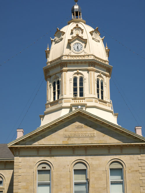 "Closeup of dome. Building has stone inscription: ""1876 Madison County"""