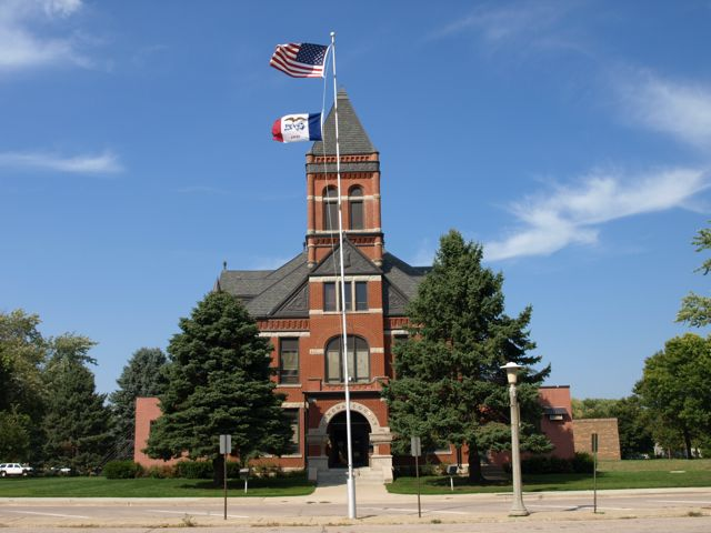 View of front of building, includes flagpole and tower