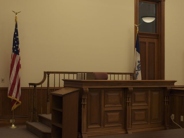 A view of the reconstructed judge's bench with U.S. flag on the left
