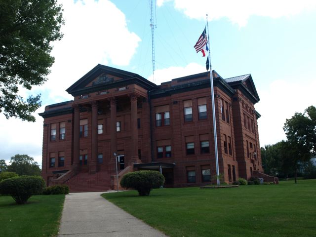 Northwest corner of the courthouse. A flagpole is in the foreground