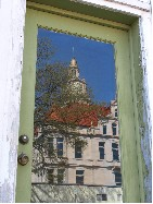 Courthouse reflected in door window