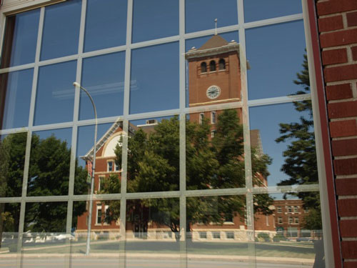 A reflection of the courthouse from a business on the square